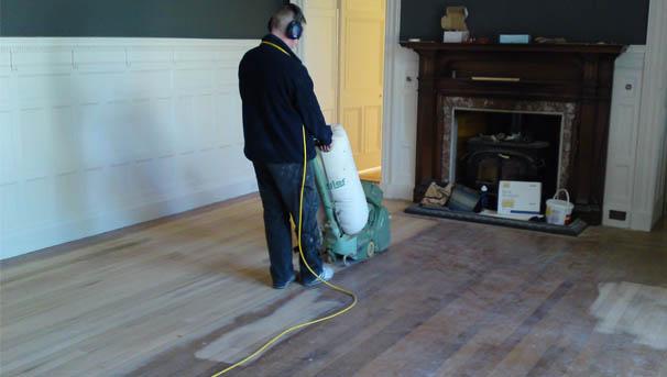 sanding floorboards